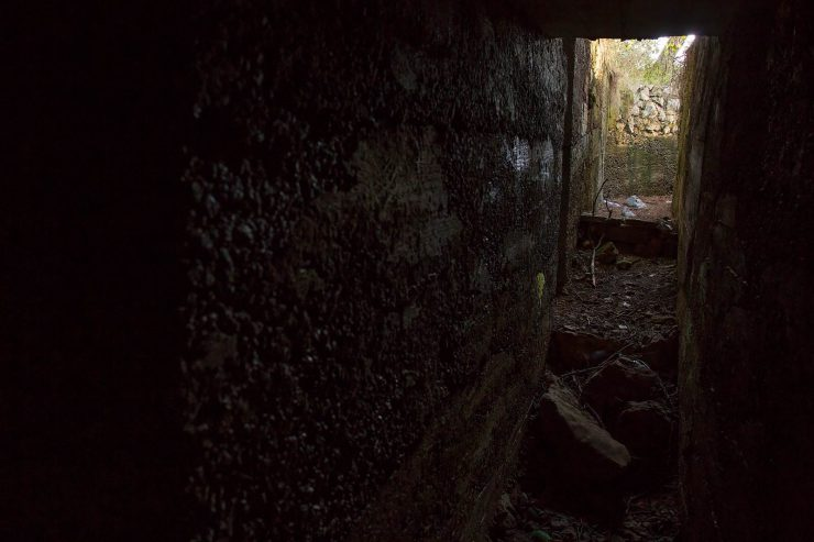 In one of the old bunkers. A tunnel to the left led to an empty storage room.