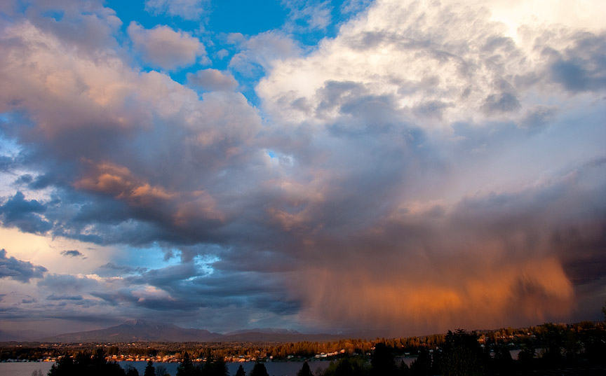 Rain and clouds highlighted by the evening sun, Lake Stevens, WA.
