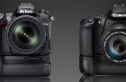A Nikon D7000 and a Canon 60D, each with battery grip