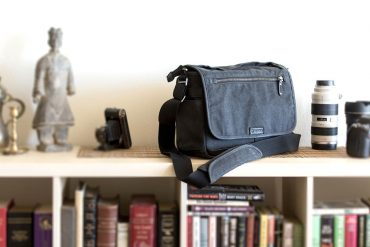 Tenba Cooper Series 13 DSLR Bag on book case.