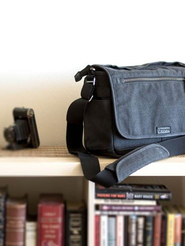 Tenba Cooper Series 13 DSLR Bag on book case.