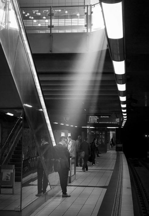 A shaft of sunlight pours down into the subway station at the Piusstraße U-bahn station.