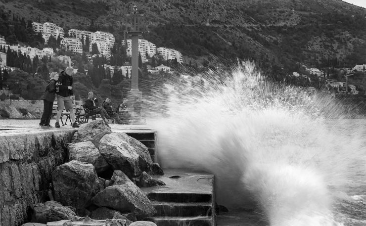 Waves on the edge of the old harbor in Dubrovnik