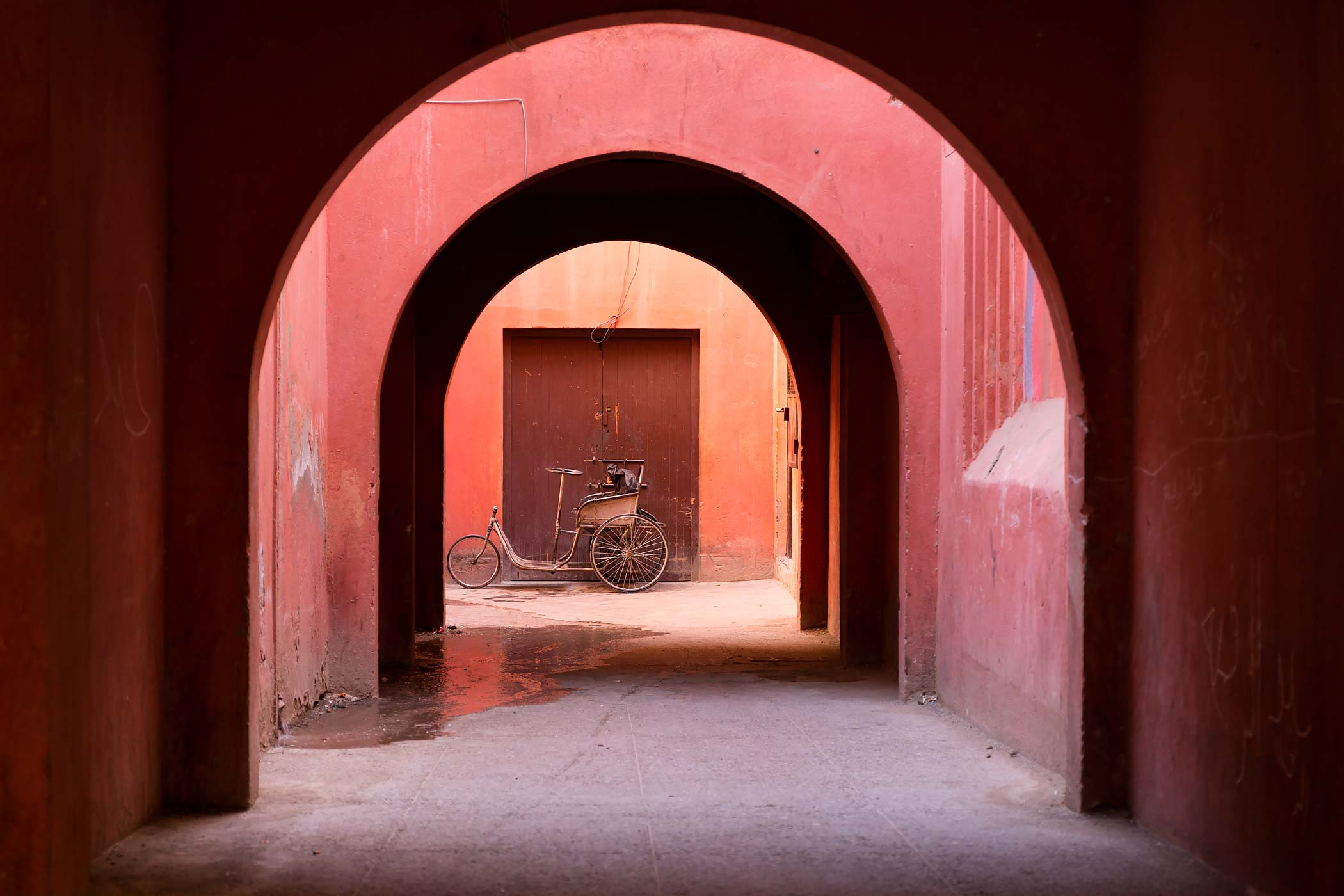 Arches and a tricycle in Marrakech, Morocco.