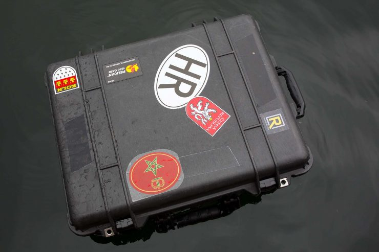 Pelican case floating in water.