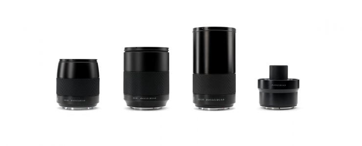 Product photo of three new lenses and teleconverter