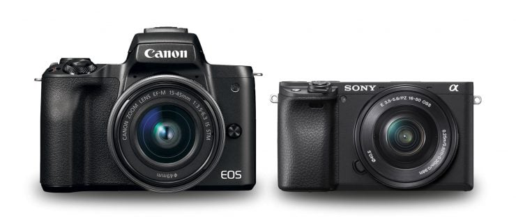 Two cameras on a white background