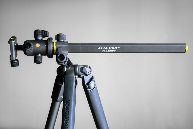 The Vanguard Alta Pro 2+ tripod against a grey background with the center column adjusted horizontally