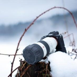 Camera in snowy scene with Polar Pro Defender Lens Cap