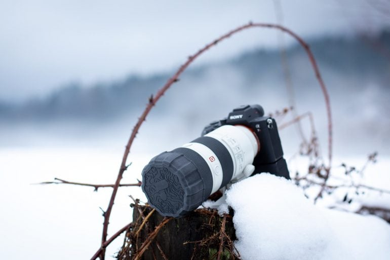 Camera in snowy scene with Polar Pro Defender Lens Cap