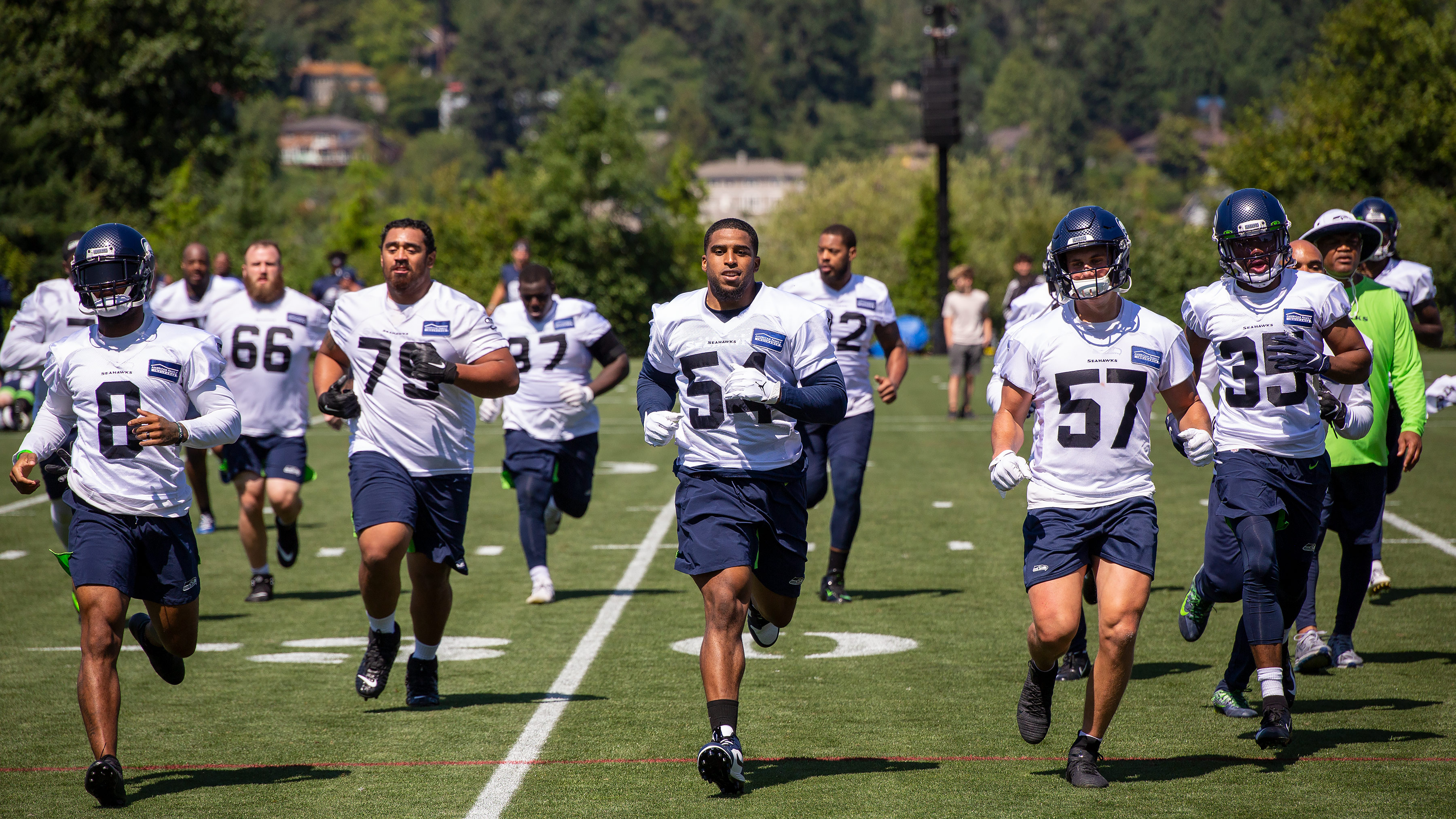 Seattle Seahawks players running at the VMAC