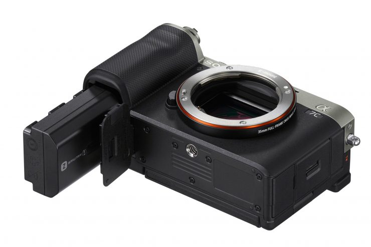 Sony A7C bottom view, battery compartment open