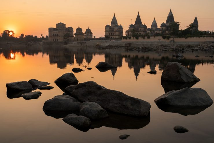 Orchha, India temples reflected in river