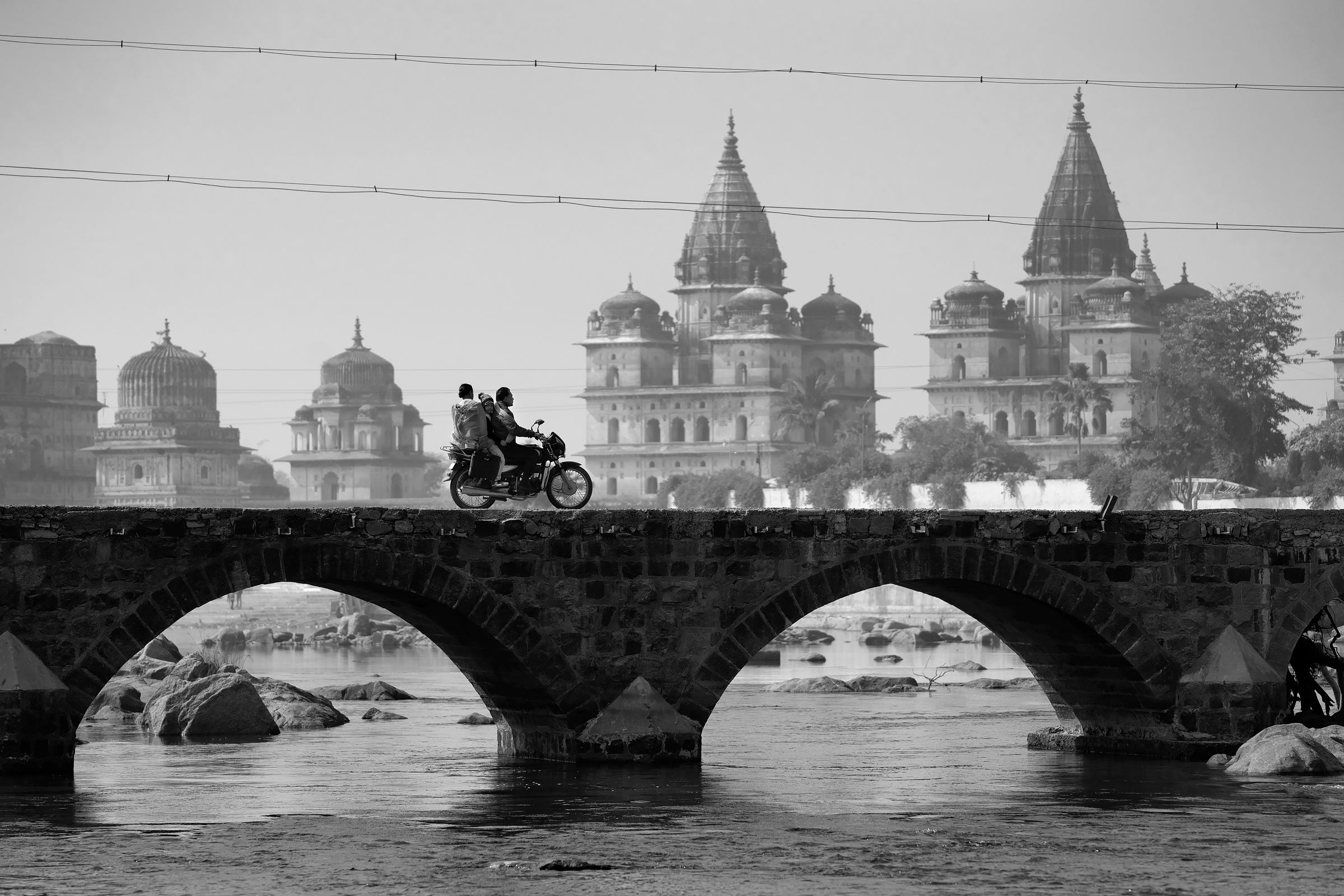 motorcycle on betwa river bridge in orchha